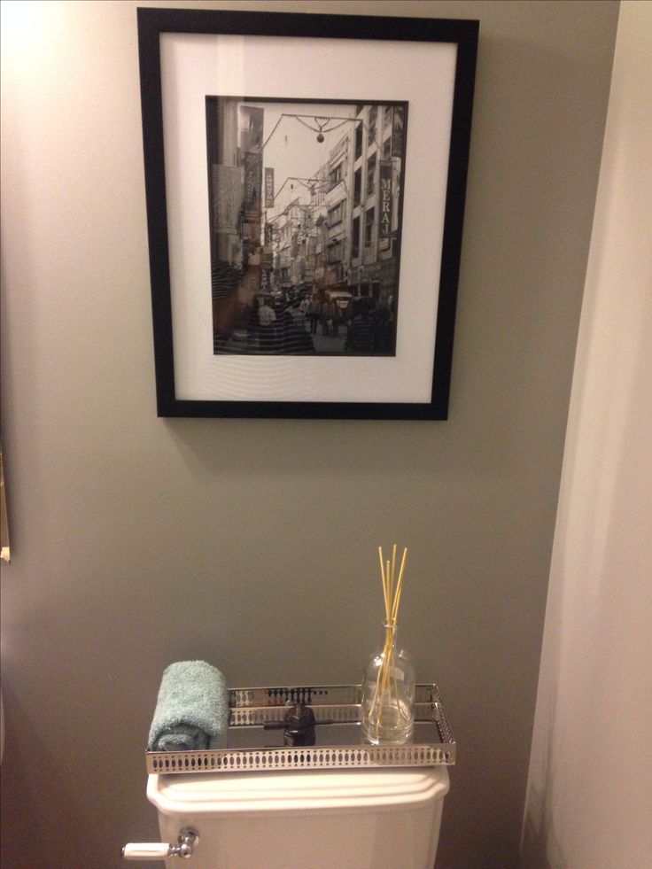 From the DIY reed diffuser (love that old port bottle!) to our wedding shopping picture in India, this main floor powder room has come together!