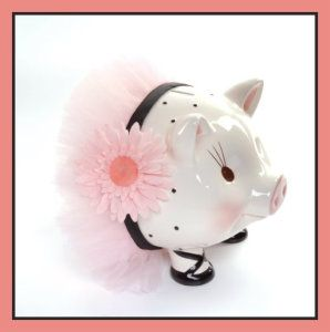 Mud Pie Baby Perfectly Princess Giant Ceramic Piggy Banks This cute ceramic piggy bank measures 9″ x 11″. The pink silk Gerber Daisy and tutu are stuck on tight, and won't come loose easily.  ATM Piggy Bank, Ceramic Piggy Banks, Disney Minnie Ceramic Piggy Bank, Disney Minnie Mouse,