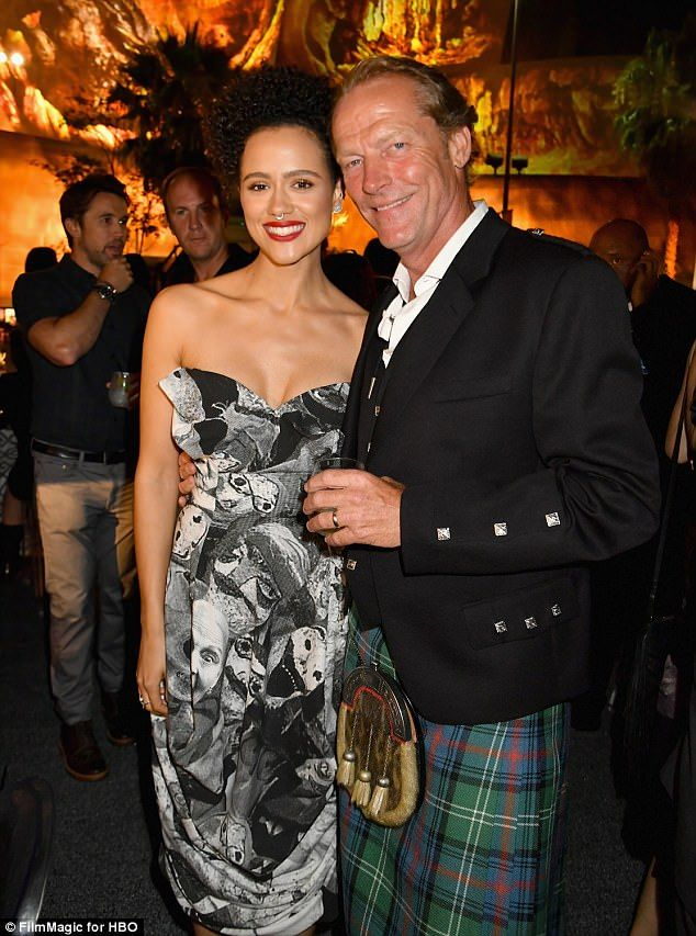 Catch up: Nathalie Emmanuel and Iain Glen caught up at the event