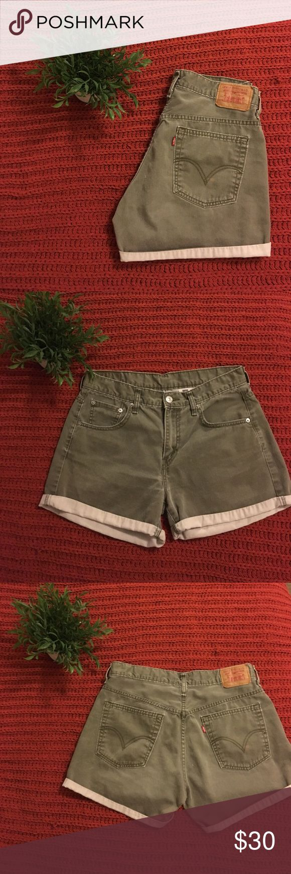 vintage olive green Levis! size L! these authentic Levis are labeled as a 10, but they would fit someone who wears a 7-9. great condition- only flaw is a faint rust colored stain on the butt pocket (see 1st picture). not noticeable when wearing! these can be rolled up (as pictured), or rolled down for more coverage. these would love to go to Coachella... :) Urban Outfitters Shorts Jean Shorts