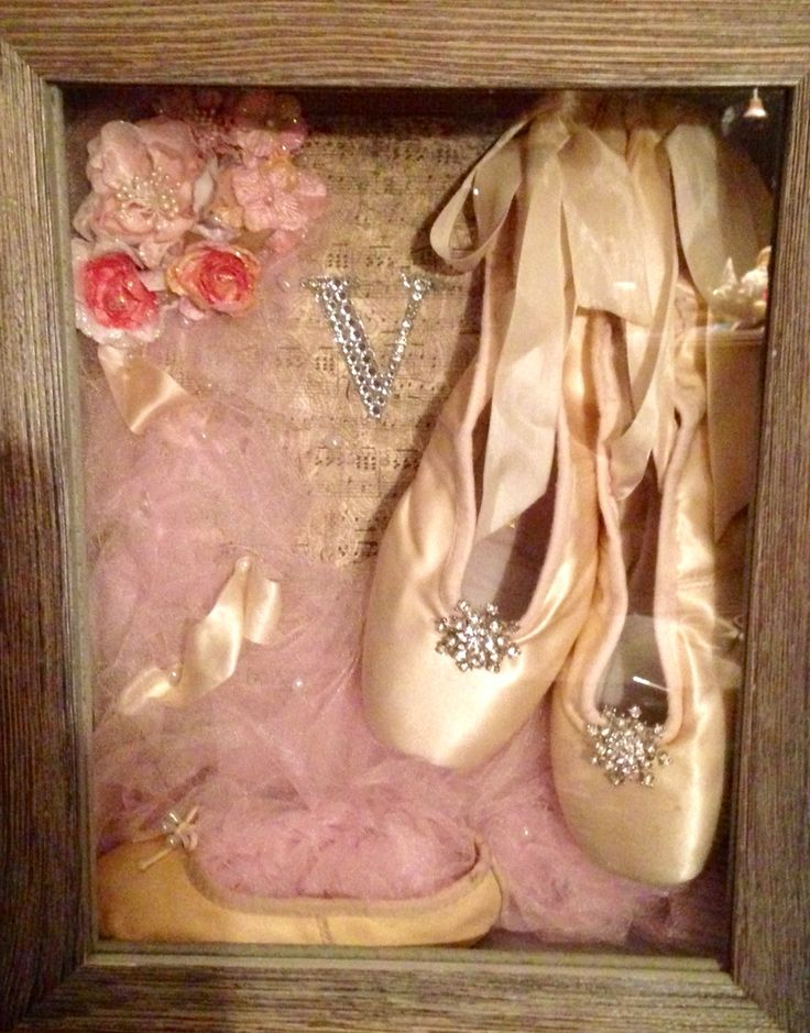 I made this Ballet shadow box for my daughter this Christmas. It displays her first and last ballet shoes.