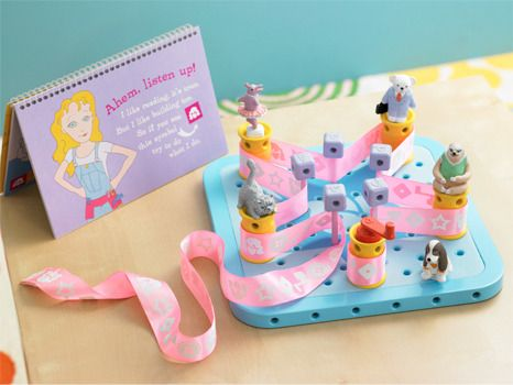 GoldieBlox...wonderful toy for young girls. google or read more at goldiebox.com