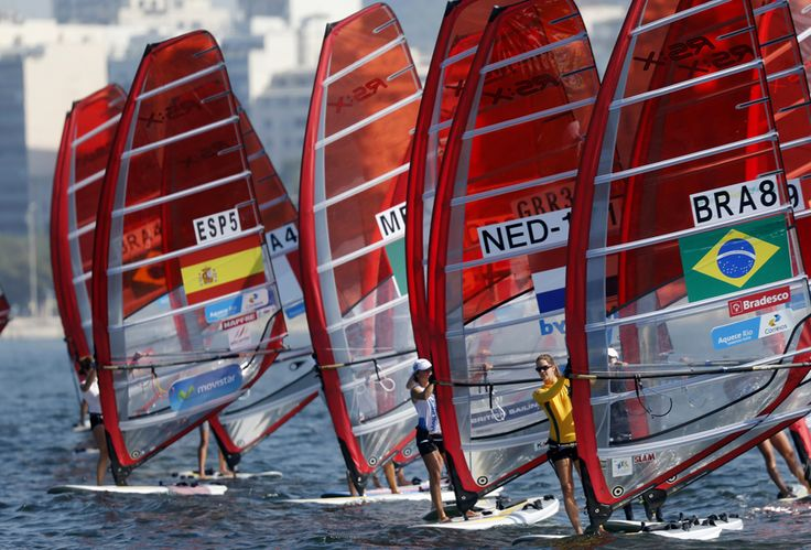 Competitors stand on their windsurfing board at the women's RS-X sailing class during the first test event for the Rio 2016 Olympic Games at the Guanabara Bay in Rio de Janeiro, Brazil August 3, 2014. REUTERS/Sergio Moraes