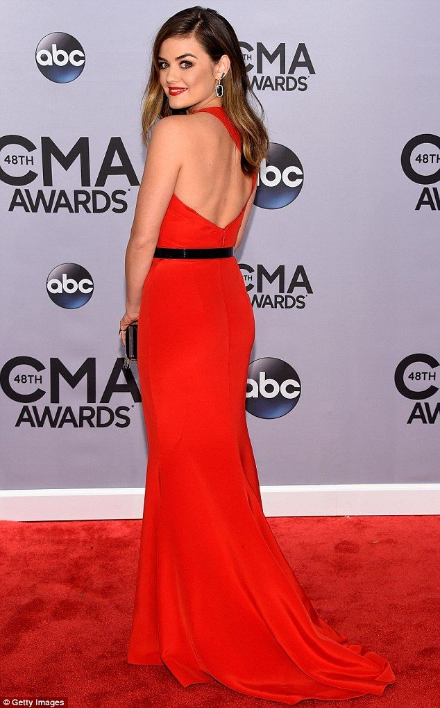 Lady in red: Lucy Hale stood out in a scarlet dress while at the CMAs in Nashville on Wednesday