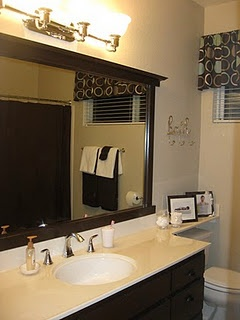 dark painted bathroom vanity with matching mirror frame before and after