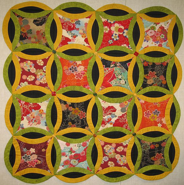 """""""Rings that Bind""""wedding ring quilt by treasureup via Flickr: """"This quilt was made using Japanese prints and given to my daughter for her 21st birthday. I used vintage bakelite buttons where the rings intersect."""""""