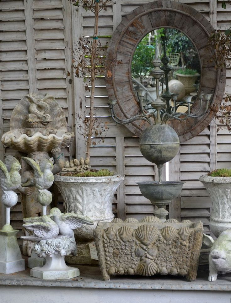 Antique Shutters As Back Drop For Pot And Garden Display