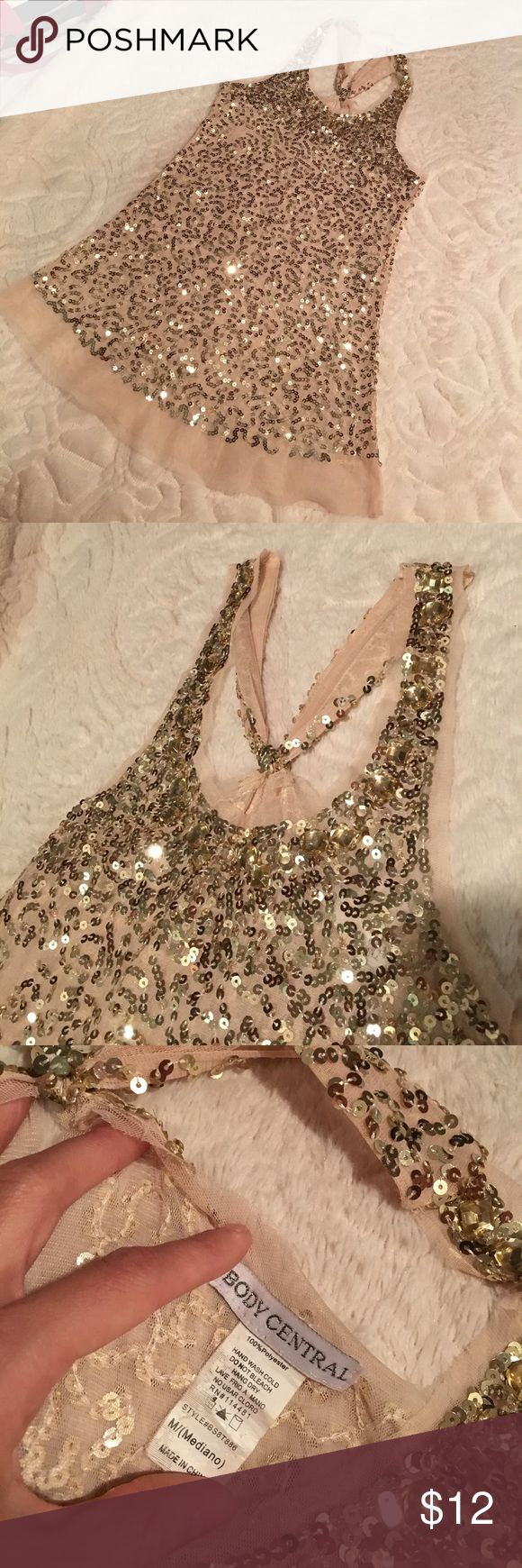 Body Central size medium!Super sexy! Sparkly tank! Body Central size medium!Super sexy! Sparkly tank! Only worn once or twice! So cute and sexy! Super sparkly 😍 sheer/mesh, gold sequins, and decorative back. Body Central Tops Blouses