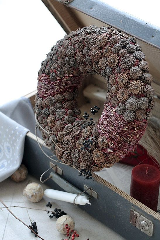 This wreath is decorated with pine cones and dried blueberry leaves.  External diameter- 37 cm (14,6 inches)  Internal diameter- 12 cm (4,7 inches)  Thickness- 5 cm (1,9 inches). $62