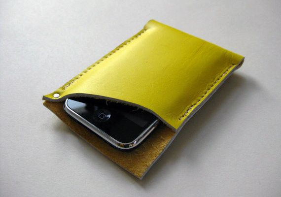Perfectly sized for your iPhone, this case is crafted from beautiful, firm, smooth finish lemon yellow leather. The case features a raw leather edge and corner rivet detail.  From Fog + Foundry. $30