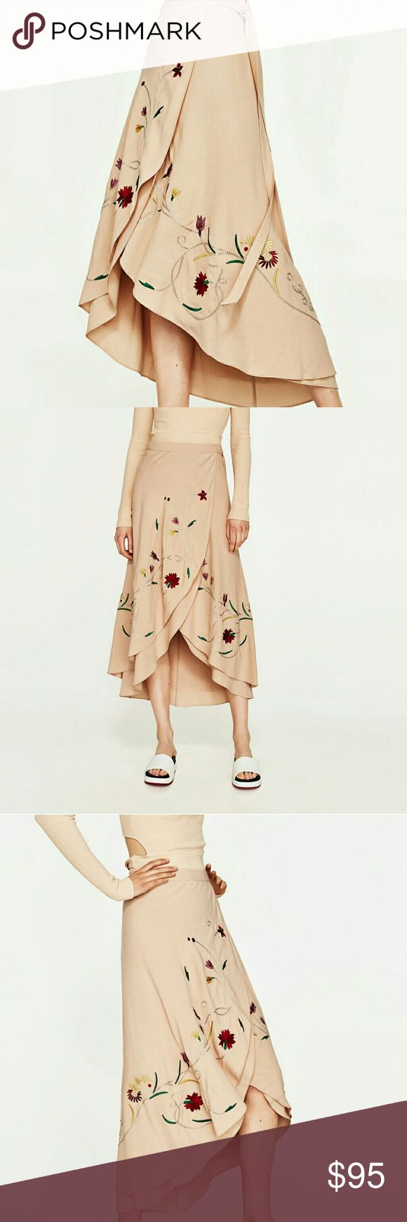 Zara floral embroidered sarong skirt Flowing sarong skirt with asymmetric hemline. Embroidered floral detailing along the bottom. Adjustable strap. Brand new with tag. No trades. Zara Skirts