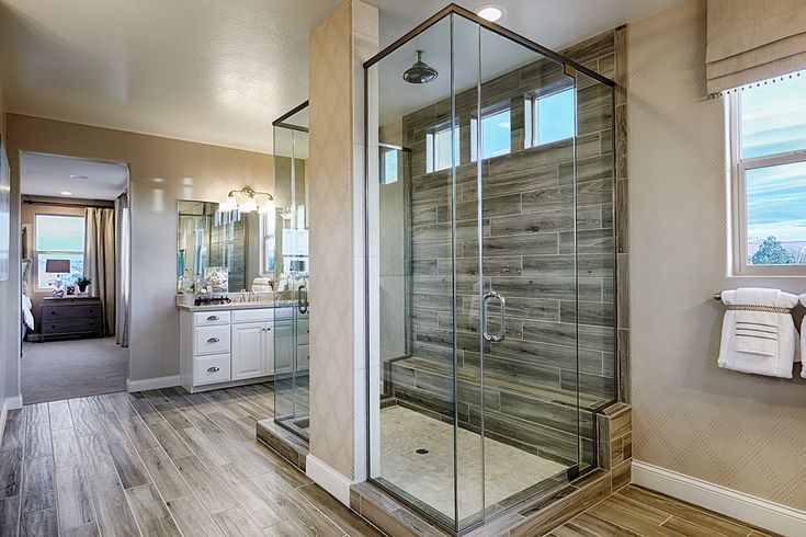 Glass-enclosed, double-sided, walk-in shower with wood-look tile. Worth every hyphen. | Sage model home | Las Vegas | Richmond American