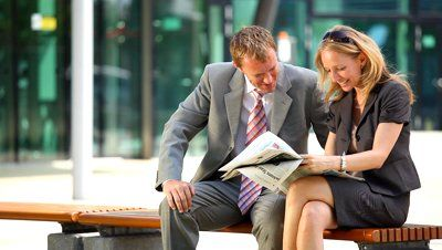 stock-footage-happy-businesswoman-and-businessman-reading-newspaper-outside-office-building.jpg (400×226)