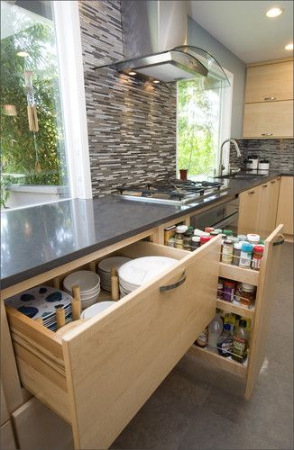 We like the deep drawer and divided area for storage for dinnerware. Pull out spice cabinet is handy next to the range. Pacific Northwest Cabinetry via Houzz