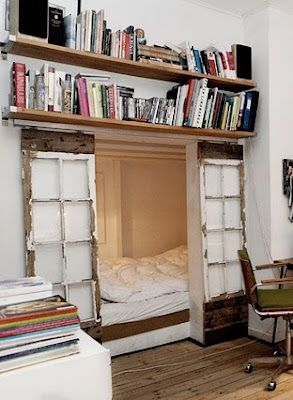 """Sleeping nook with reclaimed windows as doors. I deeply love this - I've always found the cubby/fort/hideout space very comforting. I like bunk beds, the bottom bunk, because they give one a sense of that. Though as a 6'3"""" adult, sleeping in the bottom bunk is not all that doable. Twice I've lived with my bed in a closet - this is just a much classier version of that."""