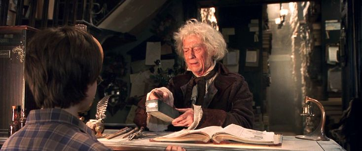 John Hurt as Garrick Ollivander helping Harry buy his first wand. Garrick has been the family shopkeeper at Ollivanders Wand Shop in Diagon Alley since the 1930s, and remembers every wand he's ever sold.