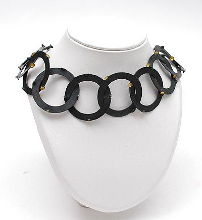 PEGGY BANNENBERG 1960 - Necklace Without title 190 grams blackened hammered silver with goldfoil design execution 1989 the Netherlands