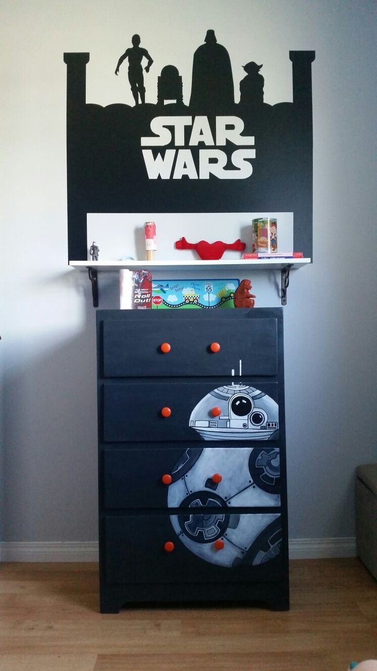 Upcycled boy's dresser with hand drawn and painted Star Wars BB8 detail. Not perfect, but he loves it.  Rustoleum Chalked paint in Charcoal and artist acrylics. Love the combo of the grey tones and orange knobs!