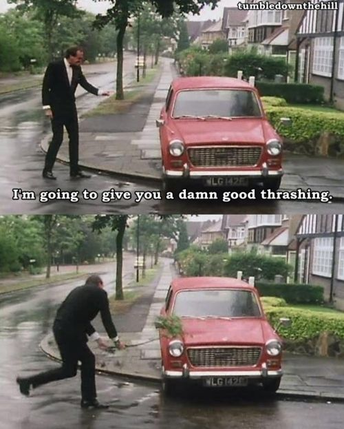 Basil Fawlty, played by the brilliant and handsome John Cleese, giving his car a damn good thrashing