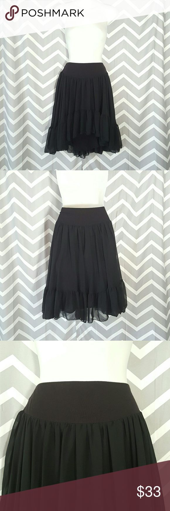 Free People black asymmetrical skirt Pre-owned in good used condition... only tiny small flaw, it has a snag on the left side (see last picture) really isn't noticeable, and there's no hole/rip. Does have lining, and the front is higher than the back. The waistline stretches, we all love a skirt with some stretch around the waist :)  The waist is a different shade of black than the bottom.  Shell 100% polyester  Lining 100% rayon Free People Skirts Asymmetrical