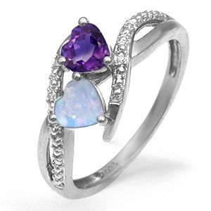 Amythest and Opal sterling silver ring. This would be really pretty. You can design your own too at kay's website.