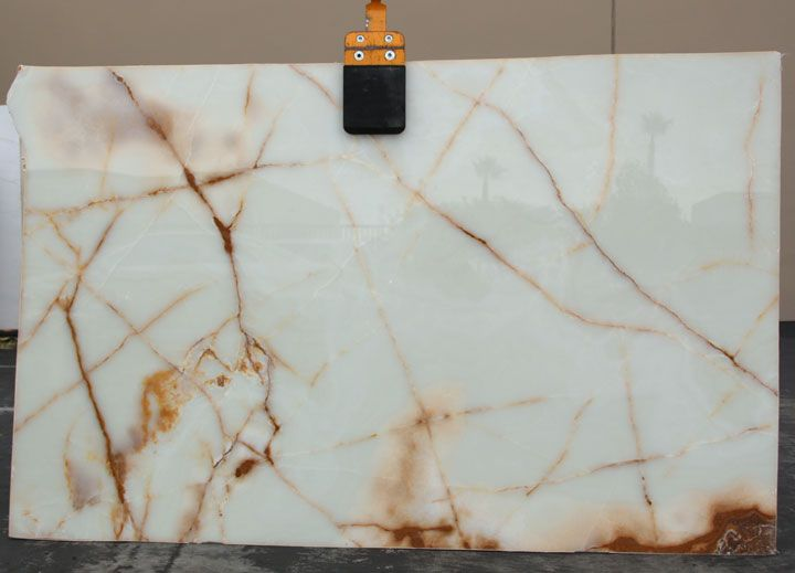 Polished White Onyx. Creme white with gold veins. Exquisite.