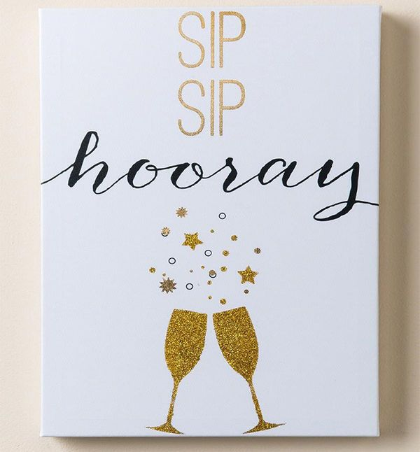 """Sip Sip Hooray Sign: Direct your friends toward the bar with a festive canvas sign to get the pre-wedding festivities started. Everyone will be excited to fill their glasses and say """"Cheers!"""""""