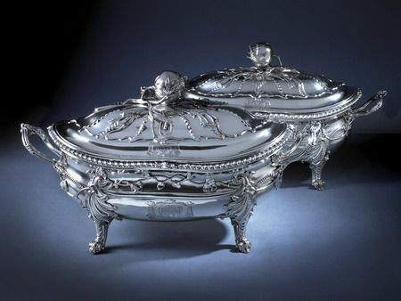 """George III Pair of Soup Tureens A fine and important pair of George III soup tureens and covers by John Romer, London 1769. The undersides are engraved with the scratch weights '125""""10 and '127""""17. Contemporary Sheffield plate liners.  Height 18 1/2 inches over handles Weight 250ozs"""