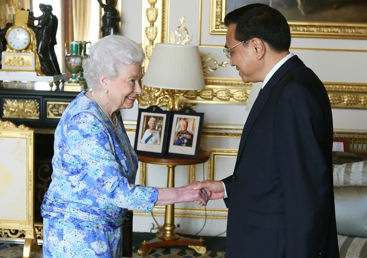 Queen Elizabeth II receives Chinese premier Li Keqiang (3rdL) and his wife Cheng Hong (2ndL) at Windsor Castle, during their visit to the UK on June 17, 2014