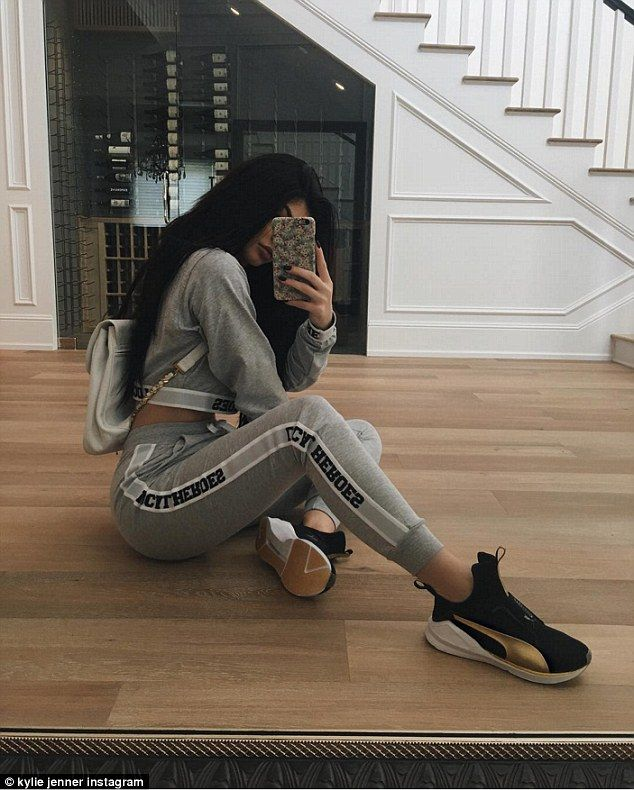 Stylish lady: The teenager complemented the sporty ensemble with a cream backpack and black, gold and white Puma sneakers