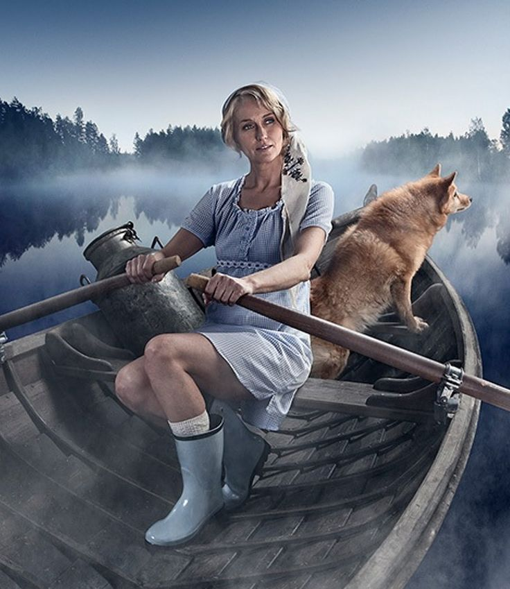 Finnish woman rowing on the lake.  Love this one!