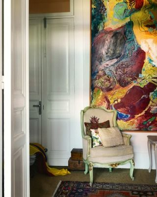 A pair of Philip Trusttum paintings from The Garden series were the first  large artworks bought by the Carringtons 10 years ago; they hang on either side of the hallway.