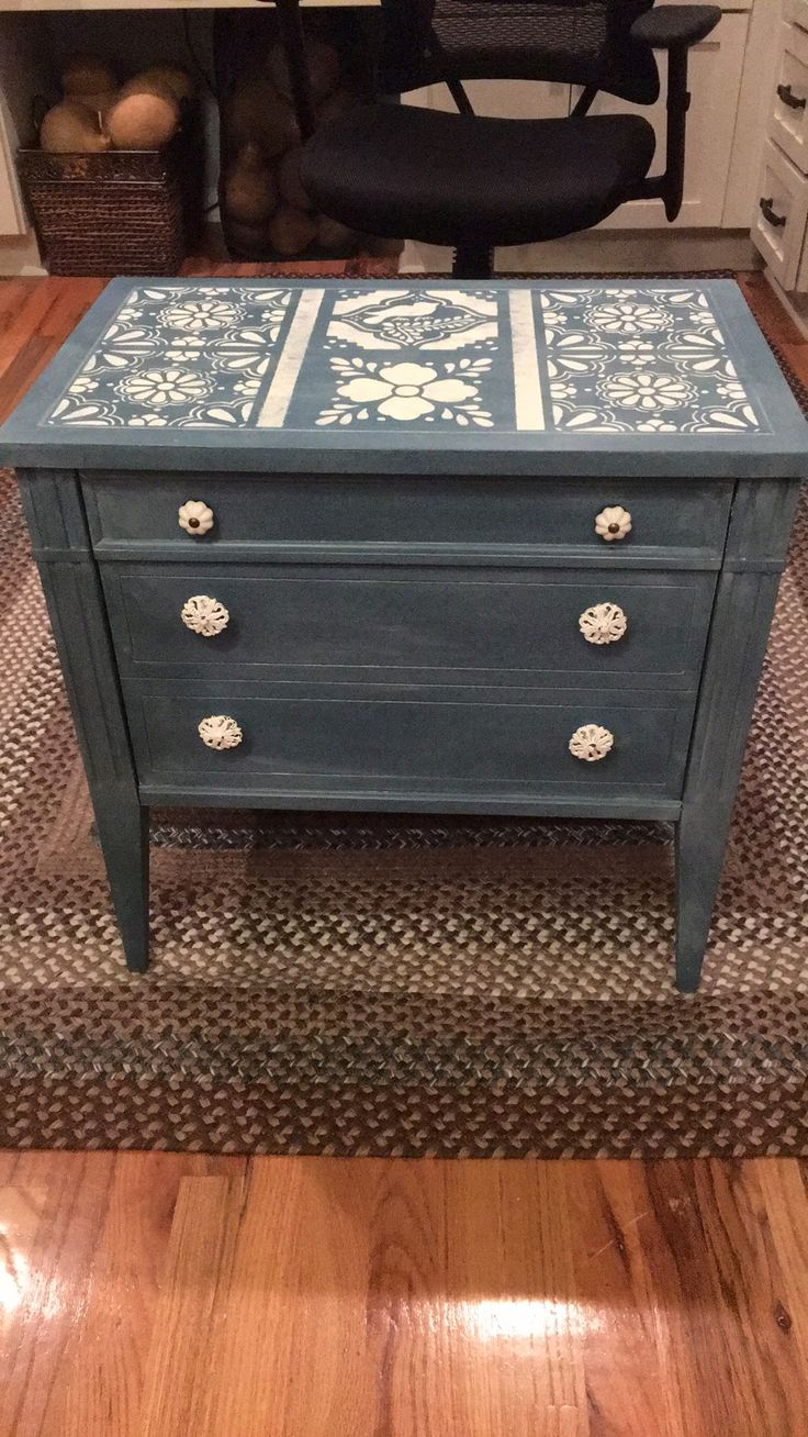Side table painted with ASCP Aubusson Blue, stenciled with Old White, and finished with soft white wax.