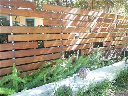 An interesting horizontal slat fence. I like the metal uprights.