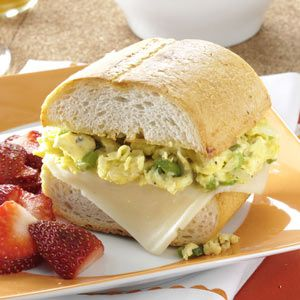 Scrambled Egg Sandwich Recipe -This savory sub is ideal for brunch, lunch or dinner. It's like eating an omelet sandwich. For variety, I use a different cheese—such as provolone—on the egg sandwich, and French or Italian bread.—Kim Dunbar, Willow Springs, Illinois