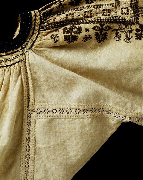 nice black work embroidery, smocking and needle lace insert work.  Murcia, Spain (probably, made)  Date:1700-1800 (made)  Artist/Maker:Unknown (production)  Materials and Techniques:Linen, embroidered with silk and with linen insertions