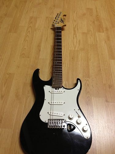 I got this black and white Lyon by Washburn electric guitar used for Xmas. I'll be buying a Honeytone mini amplifier off Amazon soon.