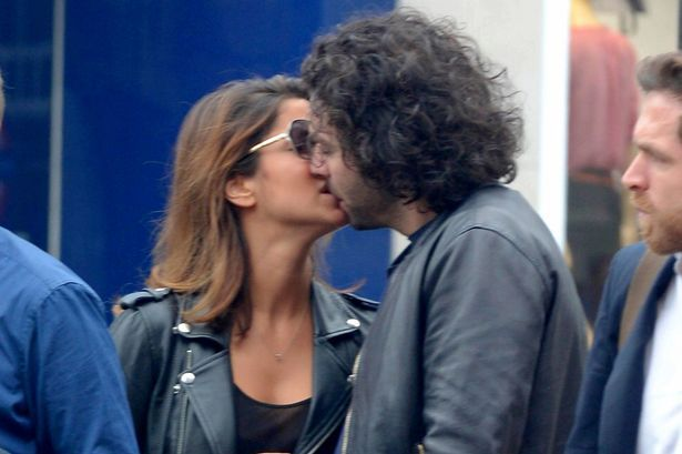 Poldark star Aidan Turner seen kissing a mystery girl in London, England on…