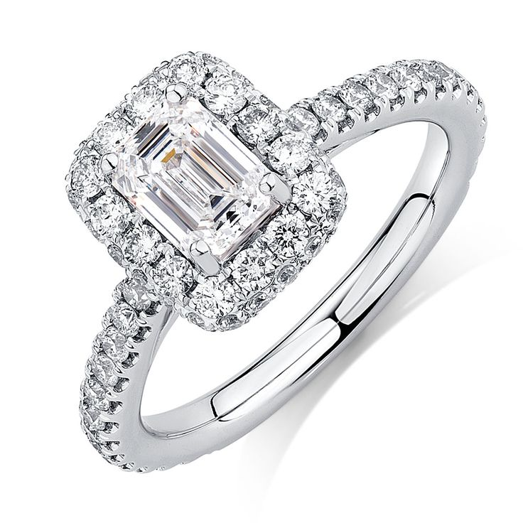 Strikingly styled in 14kt white gold, this 2 carat total weight diamond Allegro ring will turn heads. A single halo surrounds the emerald cut centerpiece, and is flanked with fine, diamond set shoulders. Accented with a pink sapphire set in 14kt rose gold, this exquisite ring will stand out from the rest. Exclusive to the Michael Hill Designer Bridal Collection.