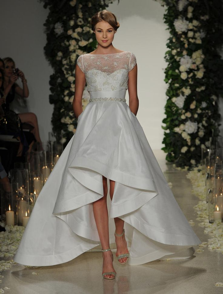 Anne Barge Fall 2016 strapless, asymmetrical high-low dress with crystal-embellished belt and topper | https://www.theknot.com/content/anne-barge-wedding-dresses-bridal-fashion-week-fall-2016