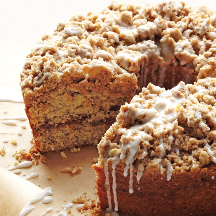 """Streusel, derived from an Old German word that means """"something strewn,"""" is quick and easy to toss together. The topping adds a sweet crunch to the sour cream cake. A basic glaze dresses up the dessert.For the banana-coconut variation, substitute walnuts for pecans. Add 1 1/2 cups mashed ripe bananas (about 3) and 3/4 cup unsweetened shredded coconut to batter at the end of step 4."""