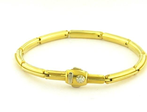 Chimento bracciale con brillante su chiusura, in oro titolo 18 kt 750 ‰ , da uomo.