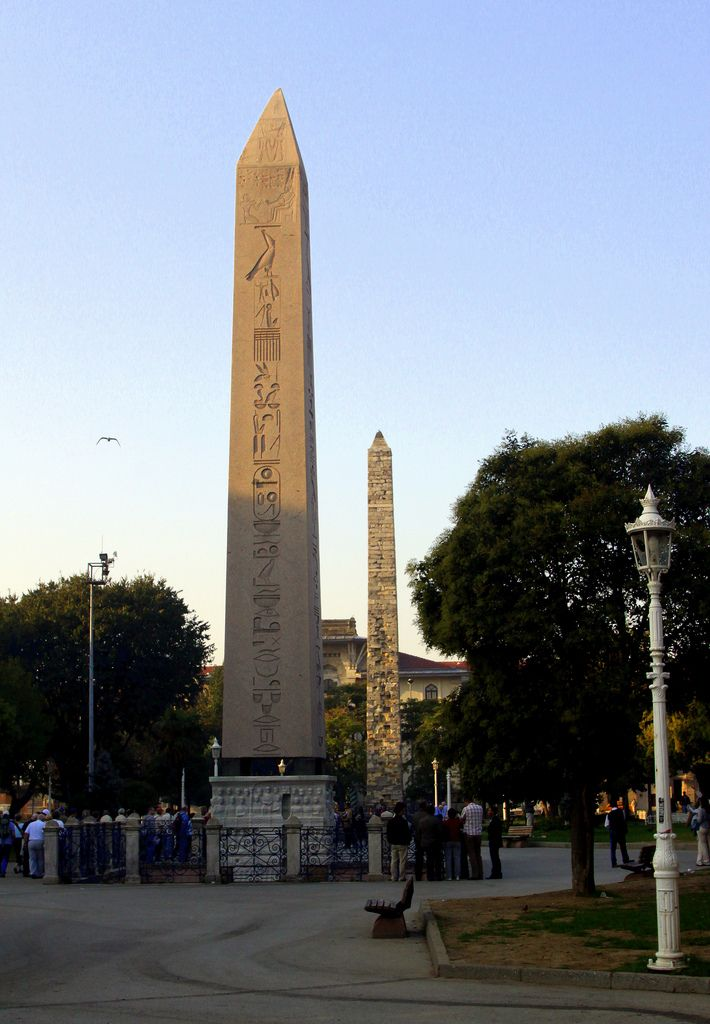 The Obelisk of Theodosius and the Column of Constantine Porphyrogenetus (Hippodrome, Istanbul).  The Obelisk of Theodosius (Turkish: Dikilitaş) is the Ancient Egyptian obelisk of Pharaoh Tutmoses III re-erected in the Hippodrome of Constantinople (known today as At Meydanı or Sultanahmet Meydanı, in the modern city of Istanbul, Turkey) by the Roman emperor Theodosius I in the 4th century AD. The obelisk was first set up by Tutmoses III (1479–1425 BC) to the south of the seventh pylon of the…
