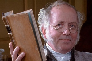 """TU53.7 """"Why, thank you, my dear,"""" Mr Bennet said, placing it on a pile of books he intended to borrow from his son-in-law. """"And did you find it useful?"""" This pic - Benjamin Whitrow as Mr. Bennet, Pride and Prejudice."""