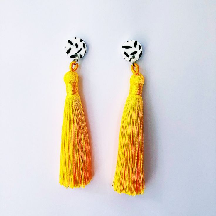FREE SHIPPING ON ORDERS OVER $50   Funky statement earrings, #handmade in Australia. Monochrome disks with thick bright yellow #tassel.  Stud back, 10 cm, 8 grams per pair.#handmadejewelry  #statementearrings .#handmadejewelry #handmadejewelryforsale #handmadeearringsforsale
