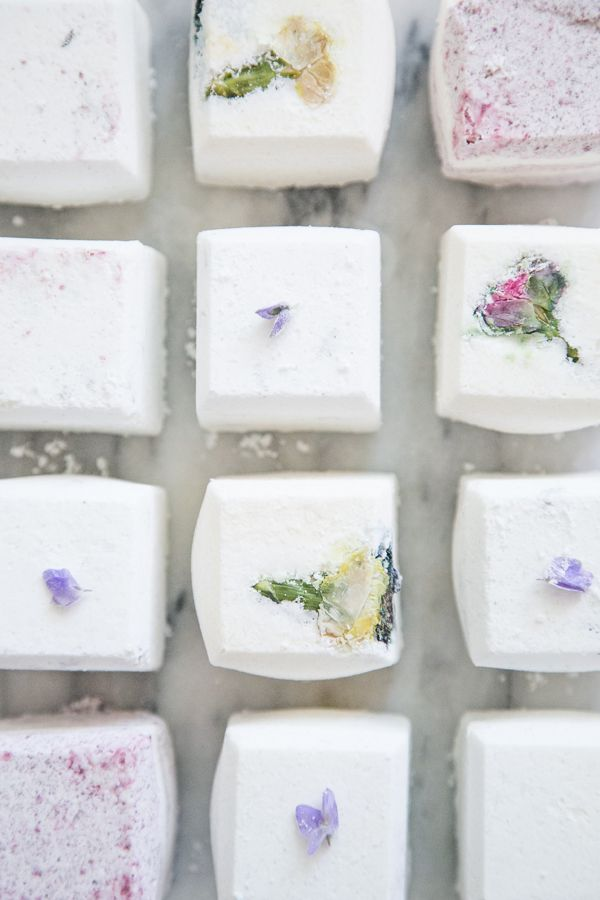 Epic Mother's Day Ideas | DIY Floral Bath Bombs made with baking soda, citric acid, corn starch, Epsom salts, essential oils, a little food coloring, and edible flowers. These soothing cubes soften and detoxify skin. @stylecaster