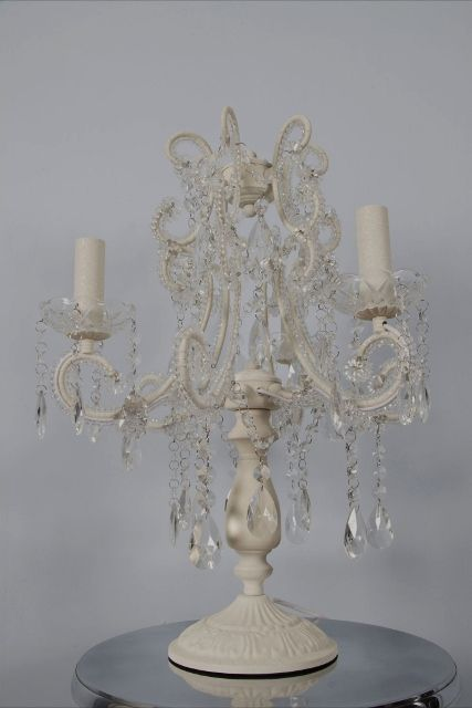 This antique white three branch chandelier table lamp is a gorgeous chandelier table lamp with antique white frame with hundreds of beads and droplets.