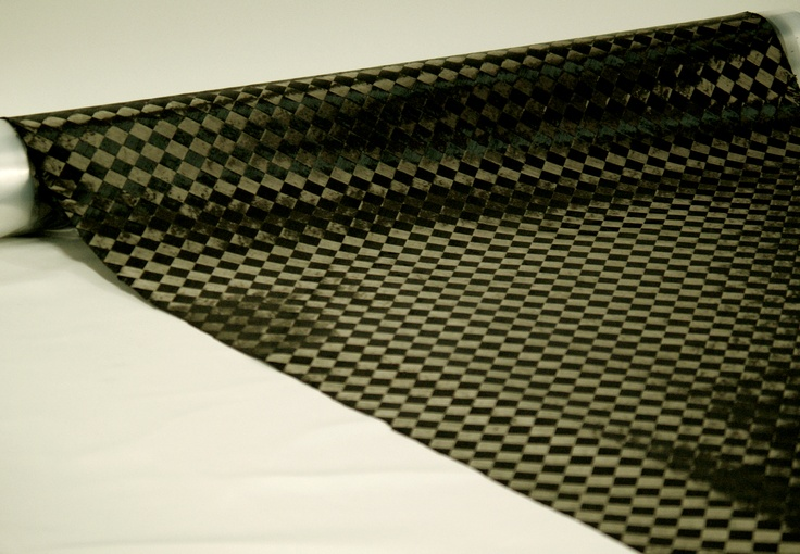 TeXtreme® Spread Tow Fabrics incorporate Spread Tow Tapes in individually adjustable angular orientations +α/-β, such as 0/90, +45/-45, +30/-30, +25/-57, etc.    This proprietary innovation enables continuous-length production of novel fabrics by interlacing two sets of Spread Tow Tapes in different angles +α/-β. These fabrics are innovative solutions for complementing the existing 0/90 variant of TeXtreme® to realize easily and quickly an optimized multidirectional reinforcement by plying.