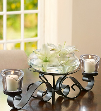 Votive candles centerpieces and dining room tables on for Dining room centerpiece ideas candles