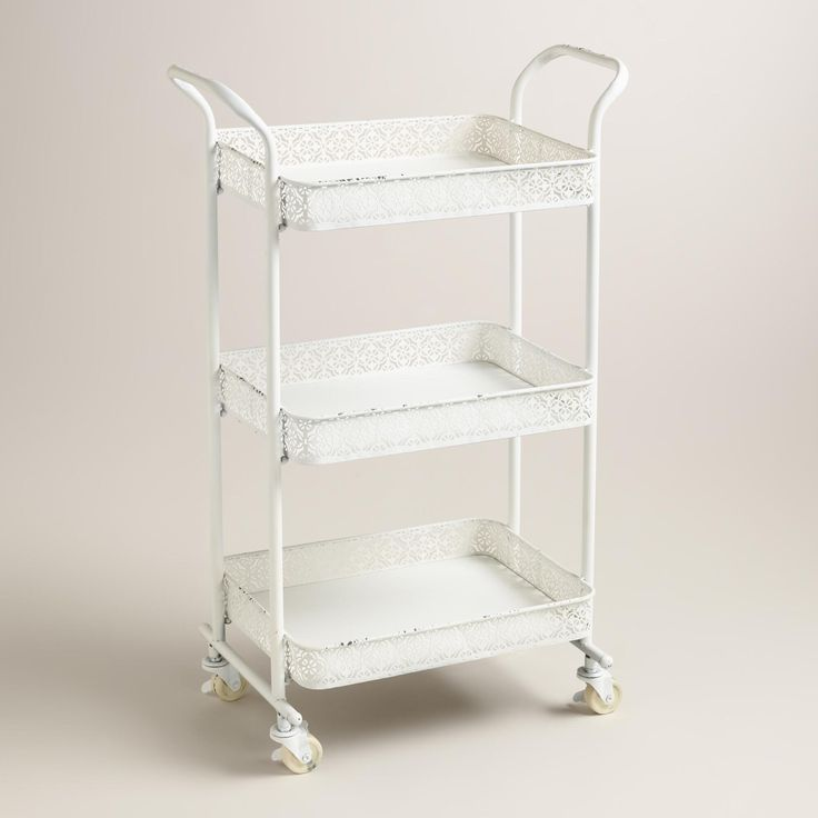 Pretty punched metal and gracefully curved handles give our white metal cart its sophisticated charm. >> #WorldMarket Bed & Bath